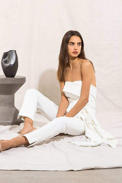 Model wears Magdelena strapless tie waist pantsuit in colour ivory