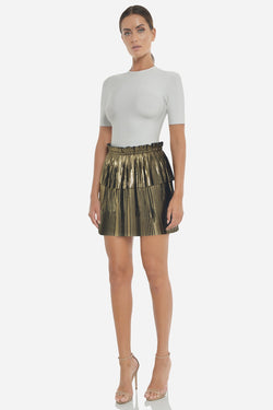 Model wears Marnie skirt in colour gold