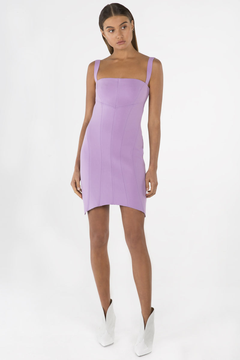 Model wears Nessie mini dress in colour lilac