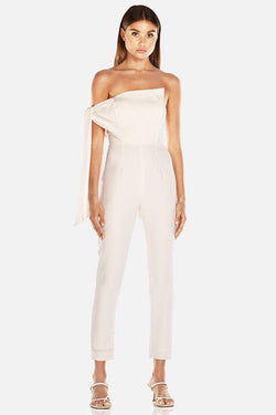 Model wears Nezan strapless pantsuit with tie on arm in colour ivory