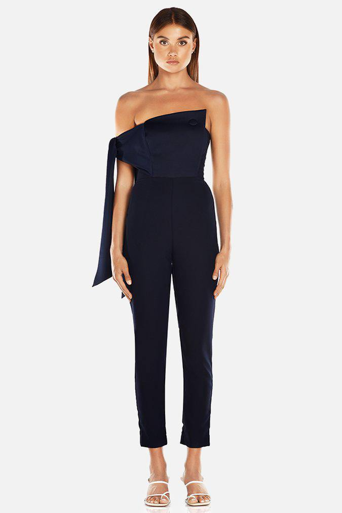 Model wears Nezan strapless pantsuit with tie on arm in colour navy