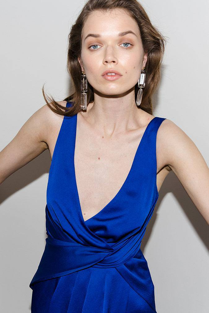 Model wearing Nyrella satin asymmetrical midi dress in colour cobalt