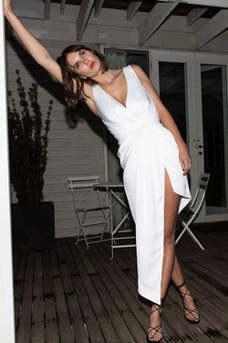 Model wearing Nyrella satin asymmetrical midi dress in colour ivory