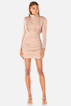 Model wears pearly crepe mini ruched long sleeve dress in colour blush