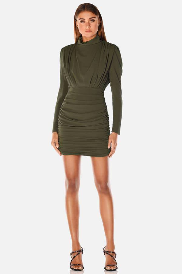 Model wears pearly crepe mini ruched long sleeve dress in colour khaki