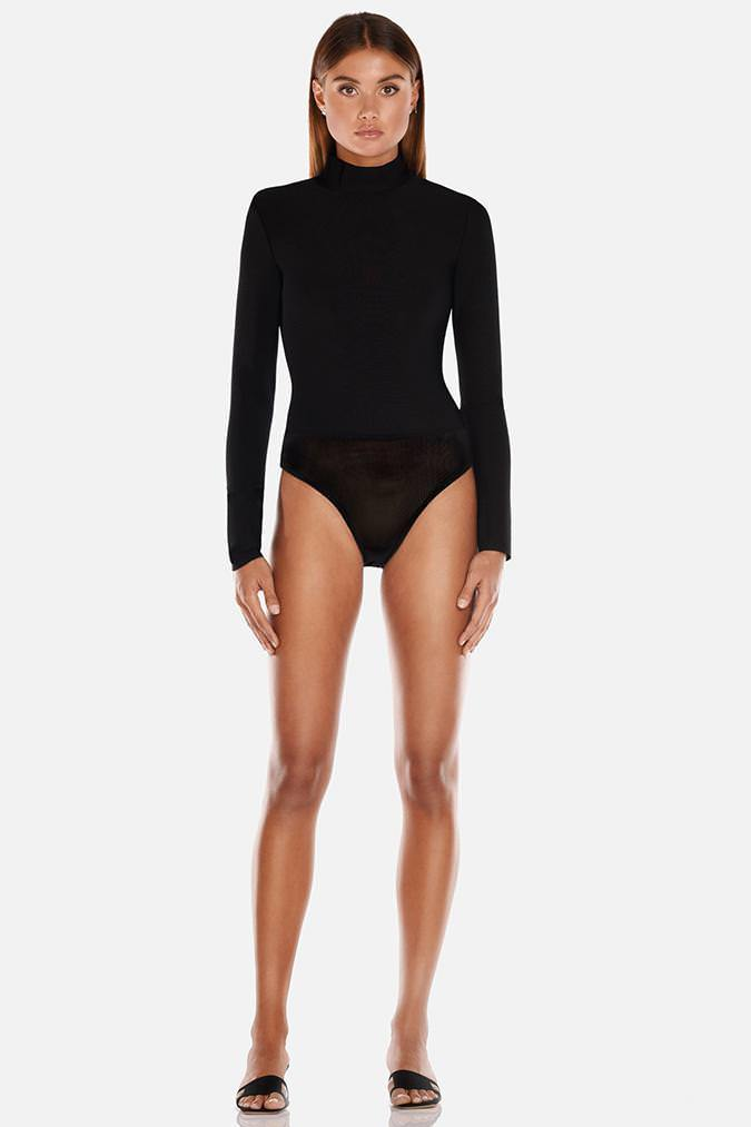 Model wears Petunia bodysuit with high neck in colour black