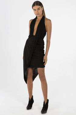 Model wears Priya mini halter neck dress in colour black