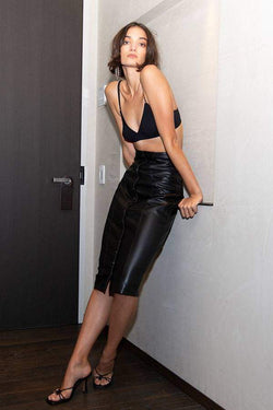 Model wears Rhiannon leather midi skirt in colour black