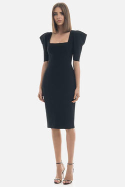 Model wears Roxanne bandage midi dress with structured shoulders in colour black