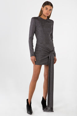 Model wears Sahara mini dress with long sleeve and sash in colour gun metal