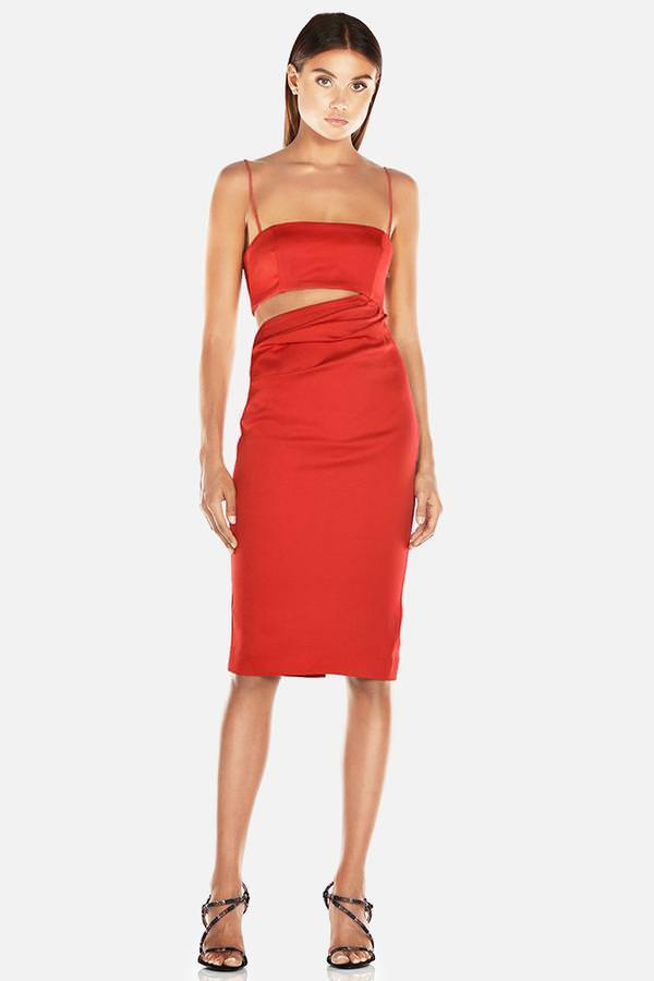 Model wears Selina slip midi dress with cut out in colour red