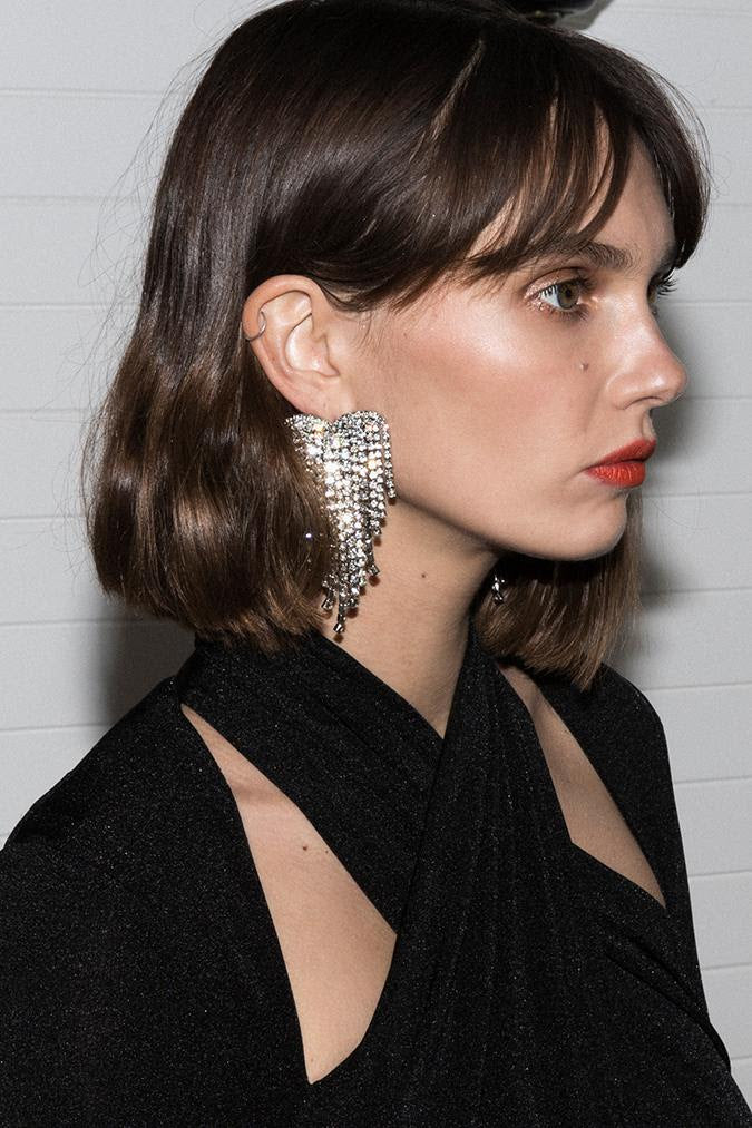 Model wears Shona tassel earring in colour silver