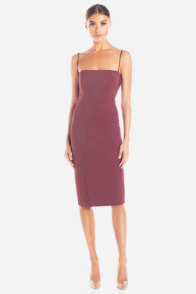 Model wears Sophie midi dress in colour plum