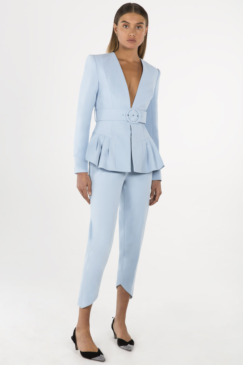 Model wears Tamina belted blazer in colour powder blue