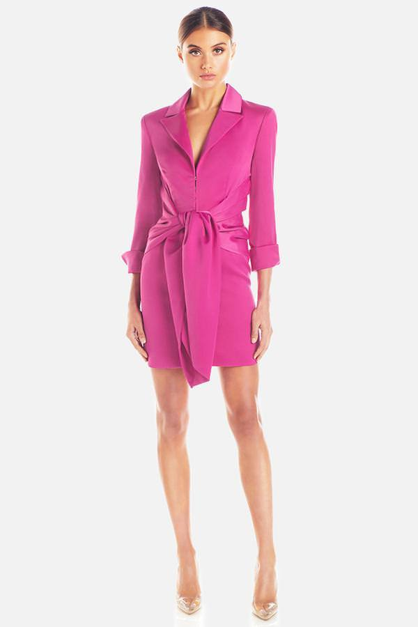 Model wears Teagan long sleeve satin tie waist mini dress in colour fuschia