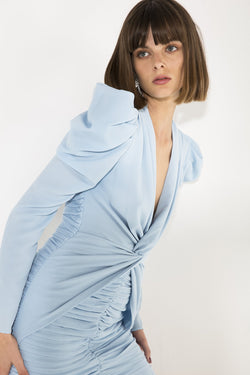Model wears Vittoria mini dress in colour powder blue