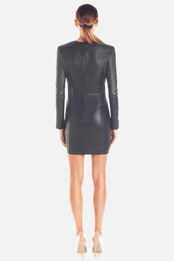 Model wears Yves leather long sleeve wrap front mini dress in colour black