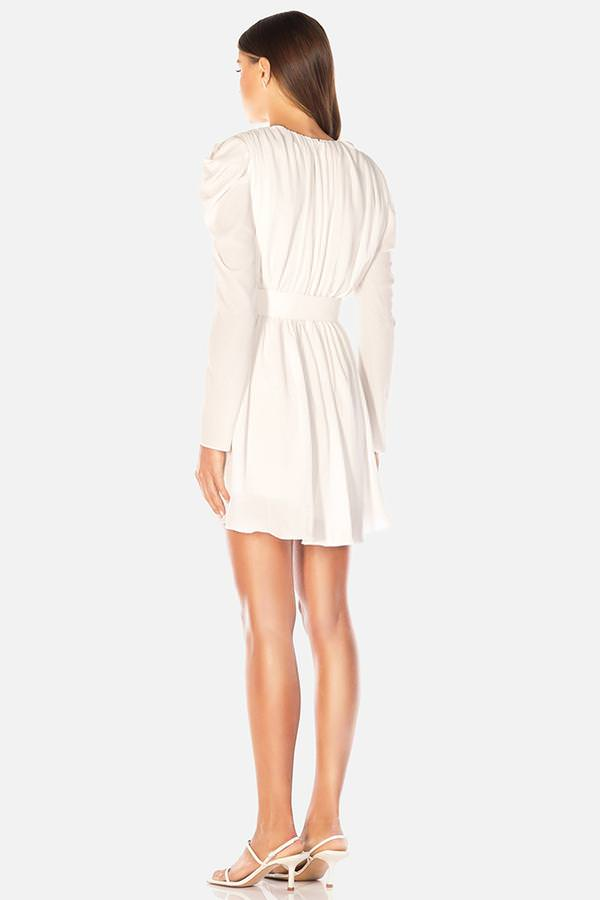 Model wearing Zahlia mini long sleeve ruched dress in colour Ivory
