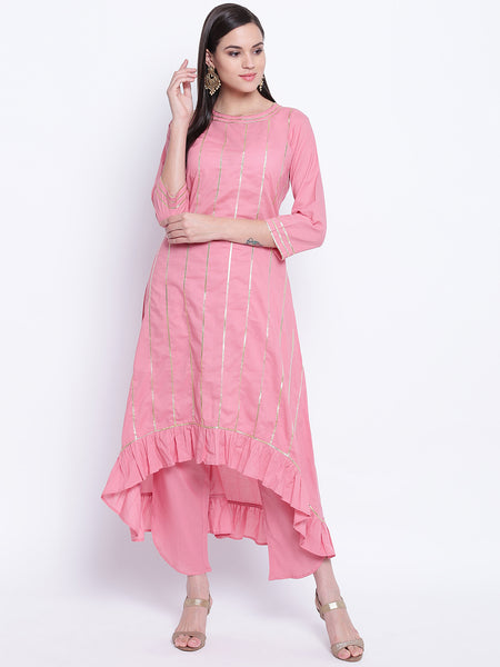 Fabnest womens cotton dull pink assymetrical hem kurta with frills and petal pants set with accents of gota.