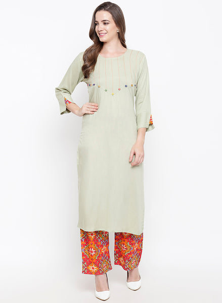 Fabnest women rayon cream kurta palazzo set with tagaai work