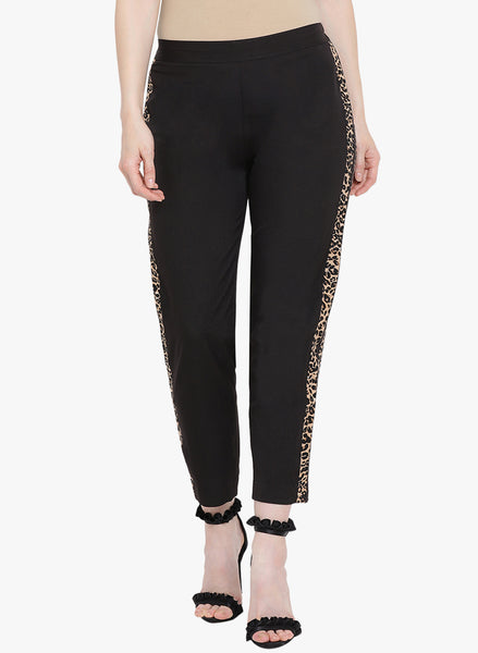 Fabnest womens black crepe straight pants with animal print stripes on the sides.