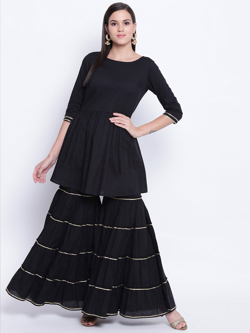 Fabnest womens cotton black peplum top sharara set with gota lace.