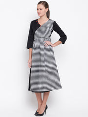 Fabnest womens cotton black angarkha style dress in solid with front pane of black and white gingham checks and accessrised with contrast red button at the neck