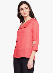 Fabnest Womens peach twill cotton top with buttons on the side and an asymmetrical neckline.