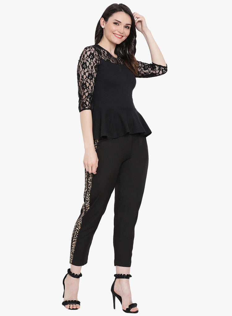 65cad21d4fc7 Fabnest womens black crepe straight pants with animal print stripes on the  sides.