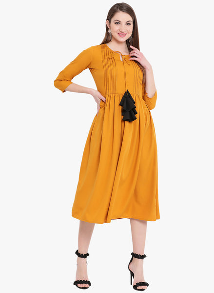 Fabnest Womens mustard dress with pintucks and tassles in crepe