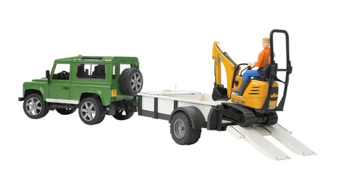 Land Rover with trailer and micro excavator