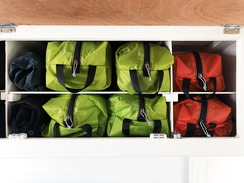 Storage pouches for clothes space saving in a campervan