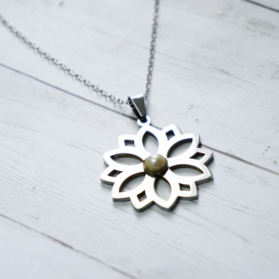 Flower with pearl necklace