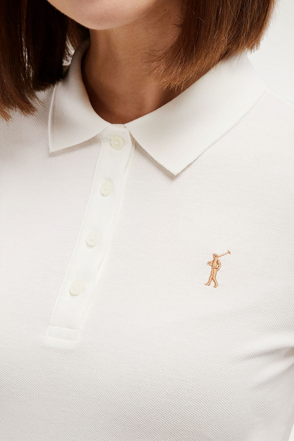 Polo beige con logo bordado
