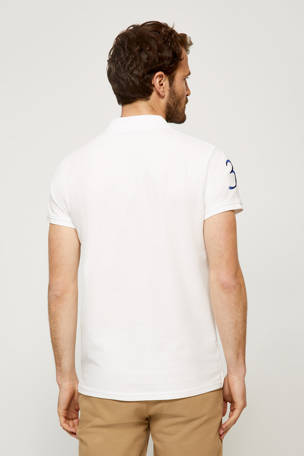 White polo shirt with nautical badge