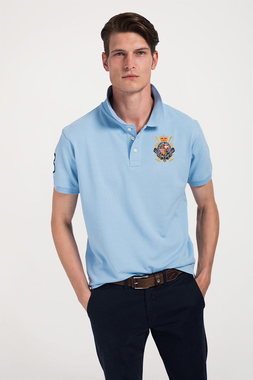 Sky blue polo shirt with nautical badge