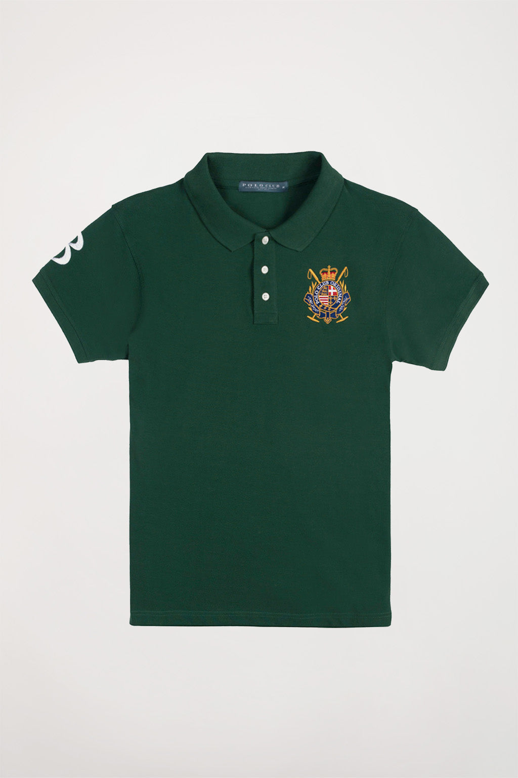 Green polo shirt with nautical badge