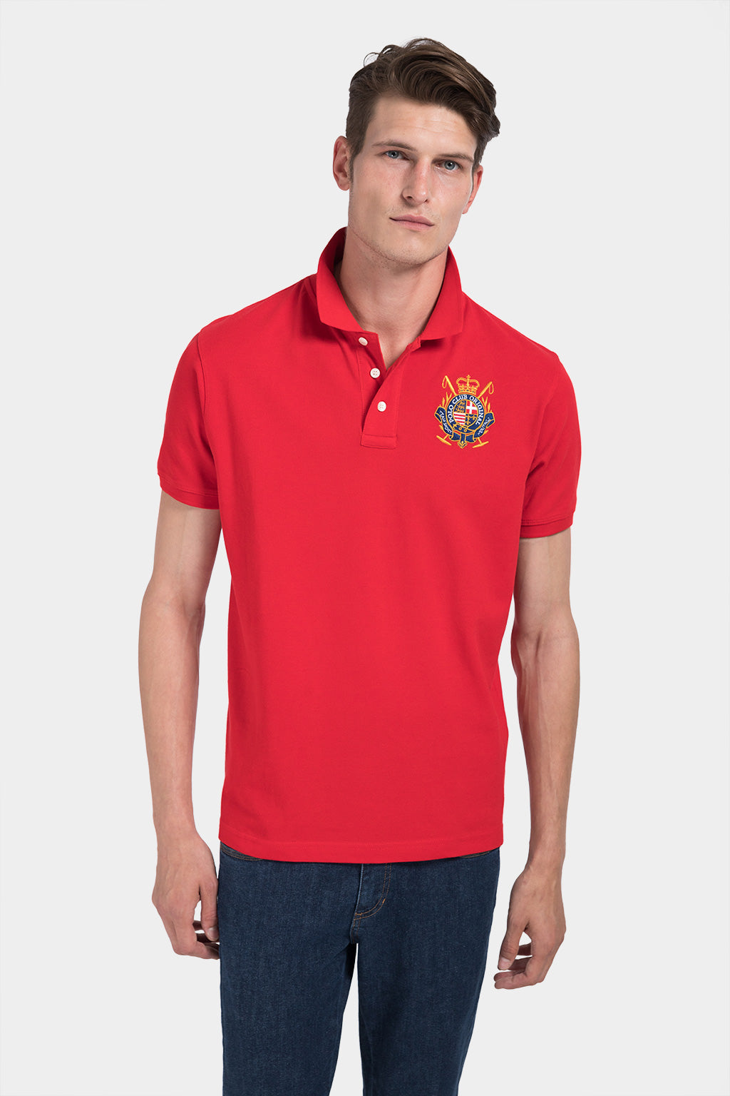Red polo shirt with nautical badge