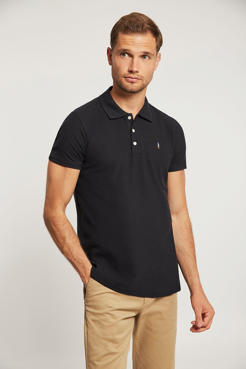 Navy blue polo shirt with multicoloured embroidery