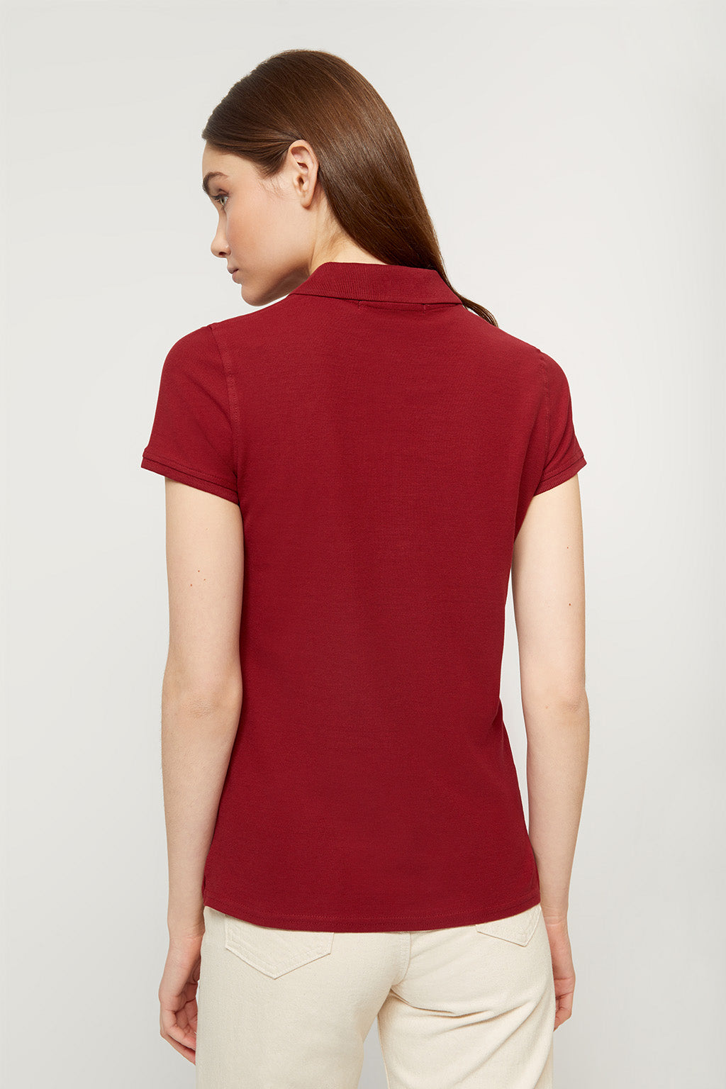 Maroon polo shirt with embroidered logo