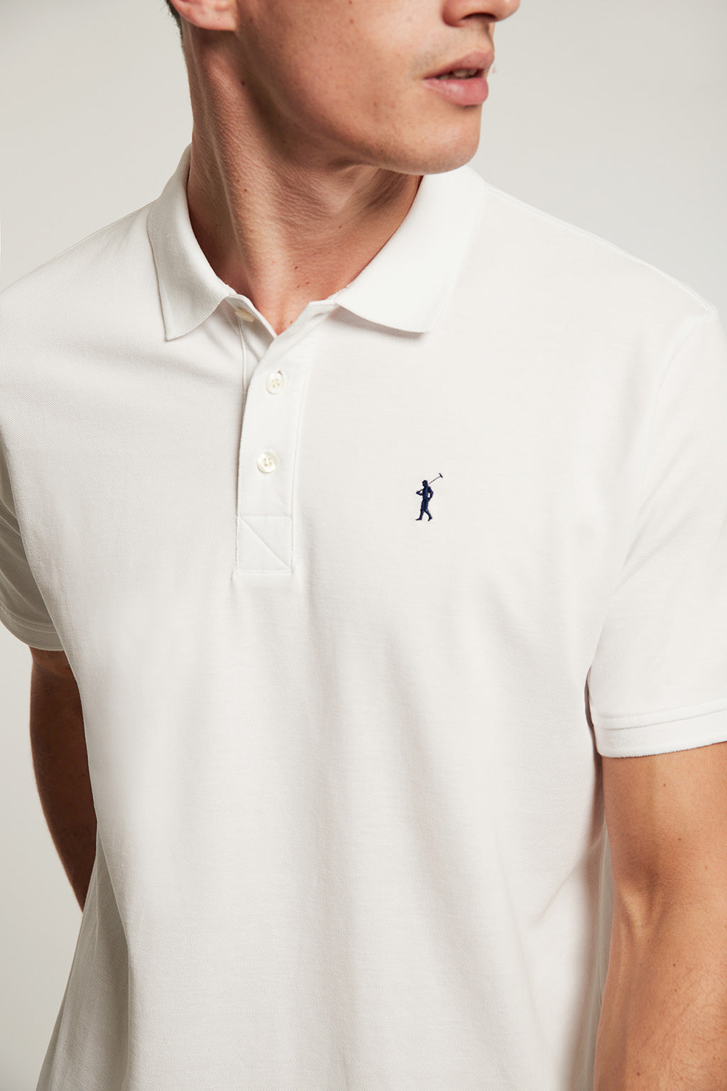 White organic polo shirt with embroidered logo