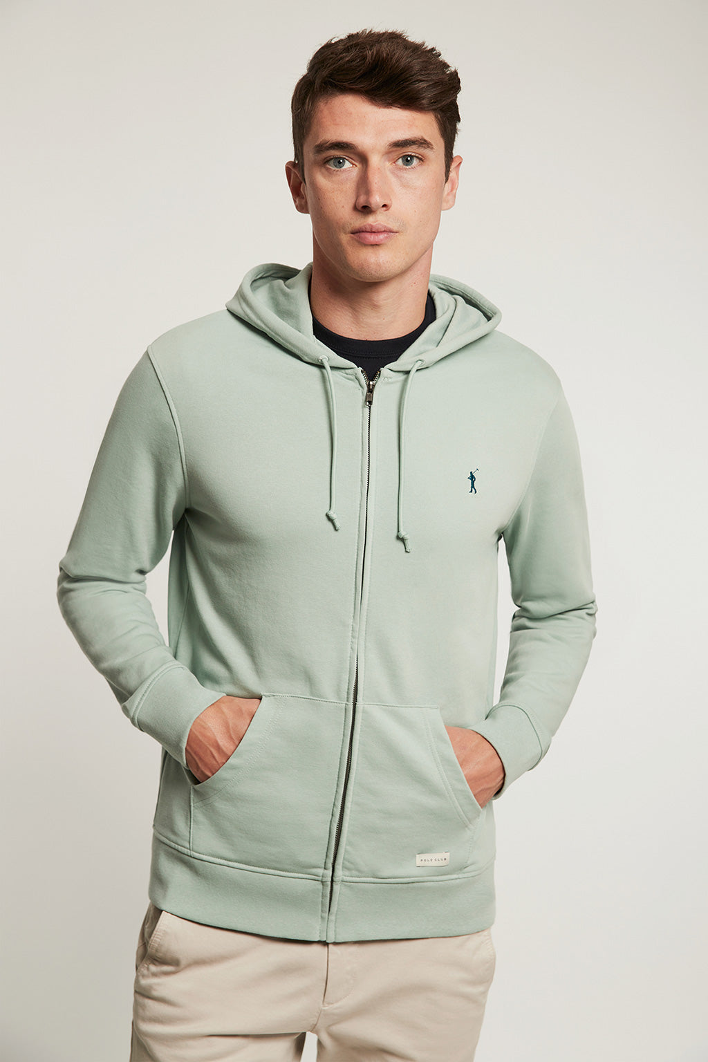 Pastel green organic sweatshirt with zip closure and contrast embroidery
