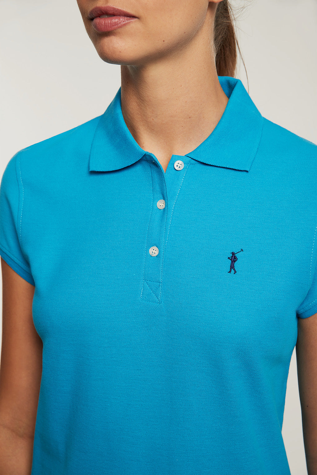 Turquoise polo shirt with embroidered logo