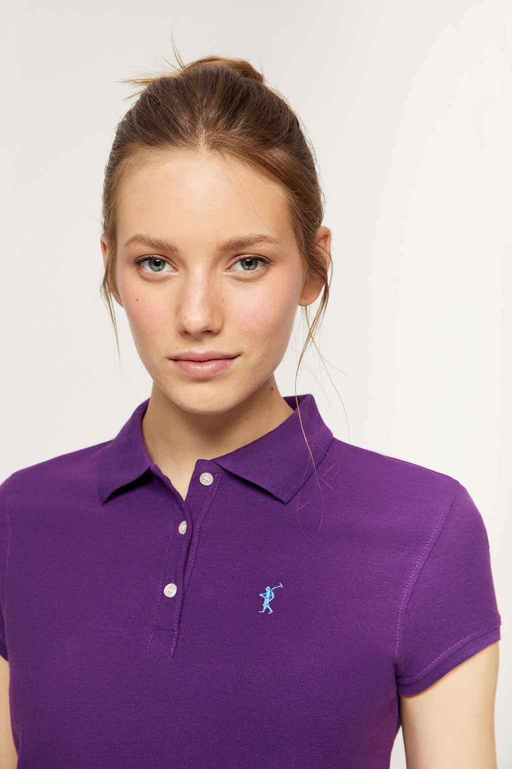 Purple polo shirt with embroidered logo