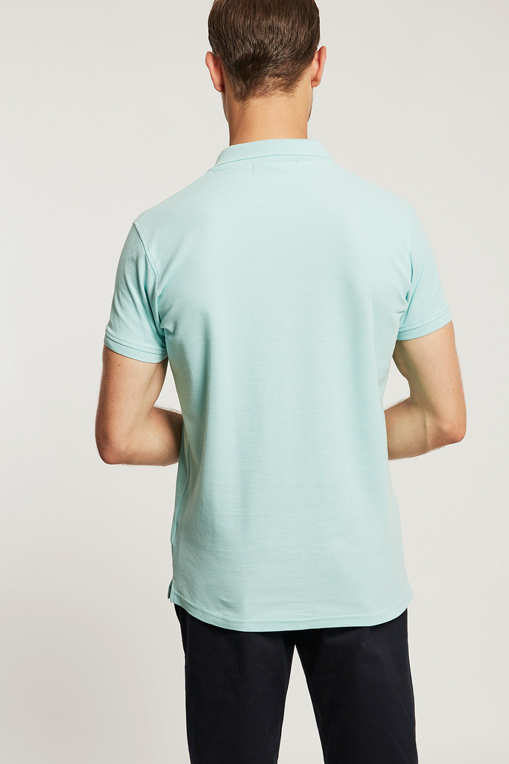 Mint polo shirt with colour embroidered logo