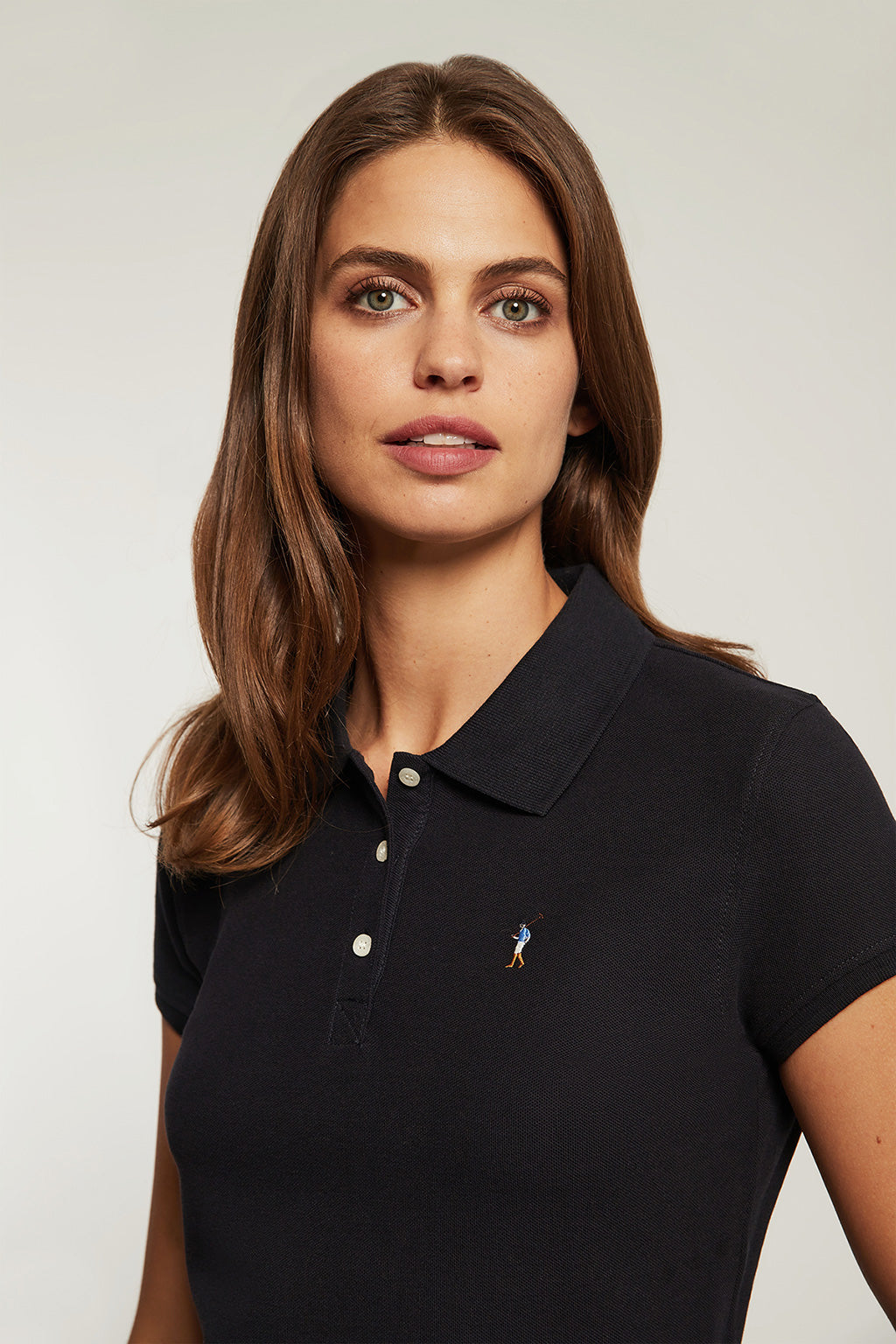Navy blue polo shirt with colour embroidered logo