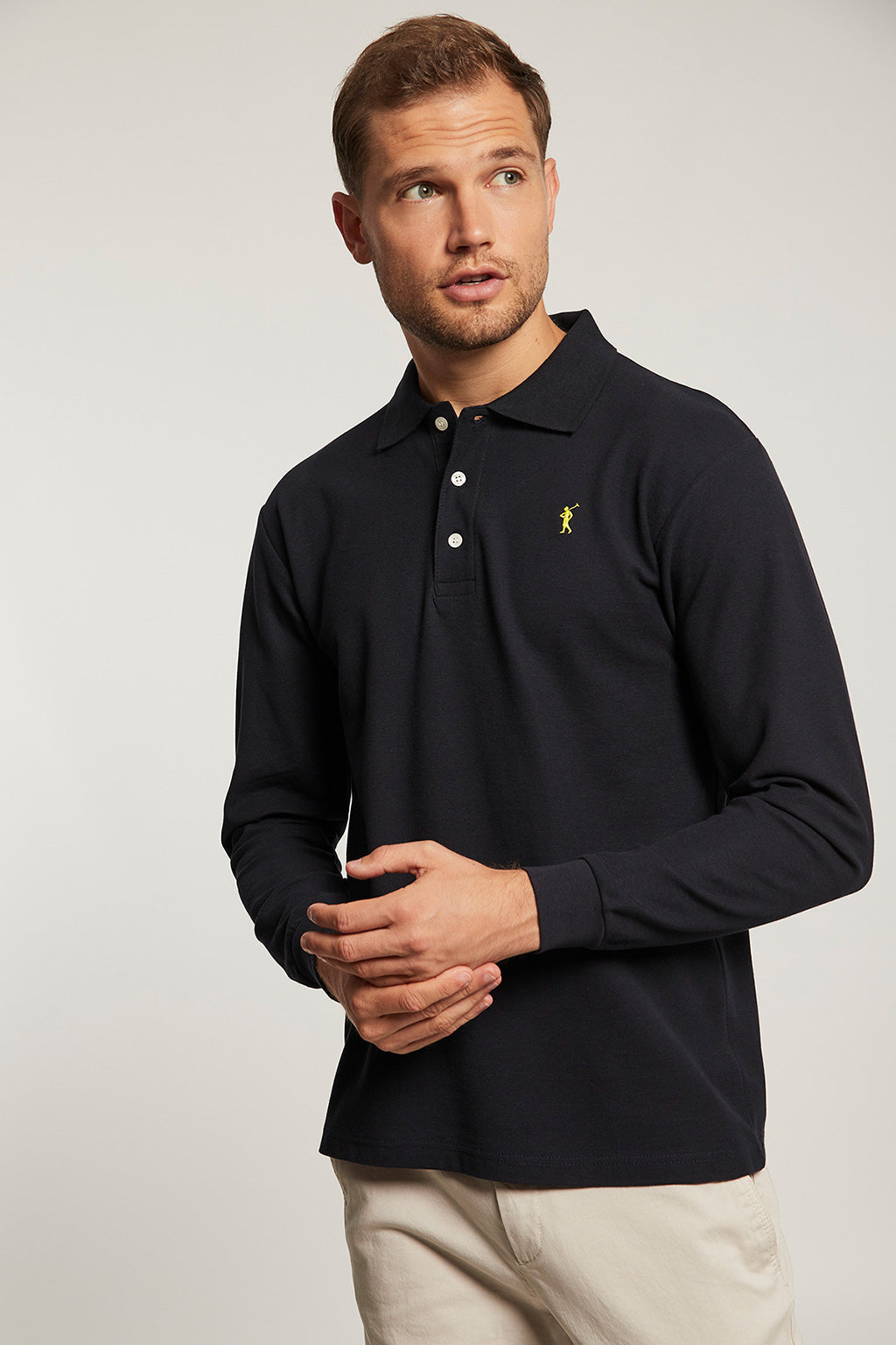 Navy blue long sleeve polo shirt with contrast embroidered logo