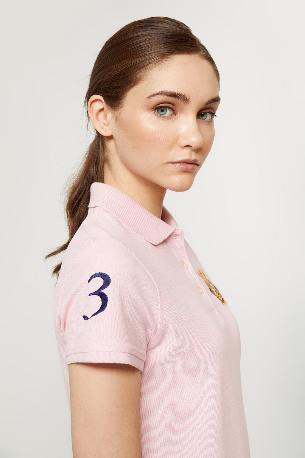 Pink nautical polo shirt with embroidered patch