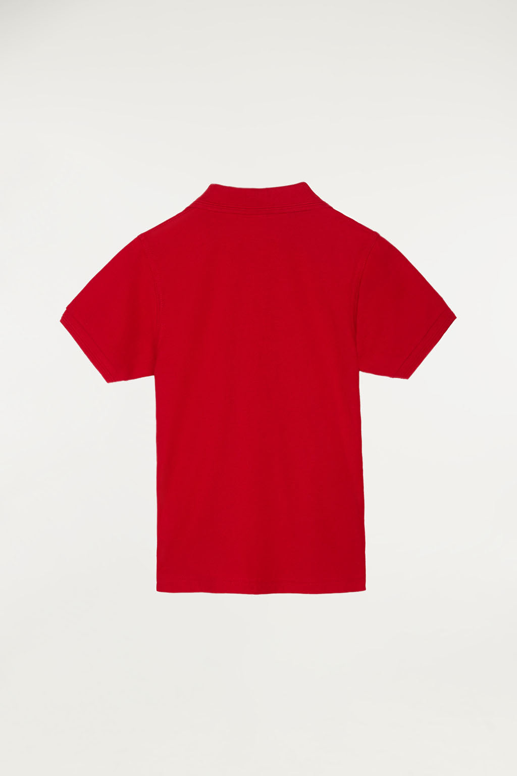 Red polo shirt for kids with contrast embroidered logo