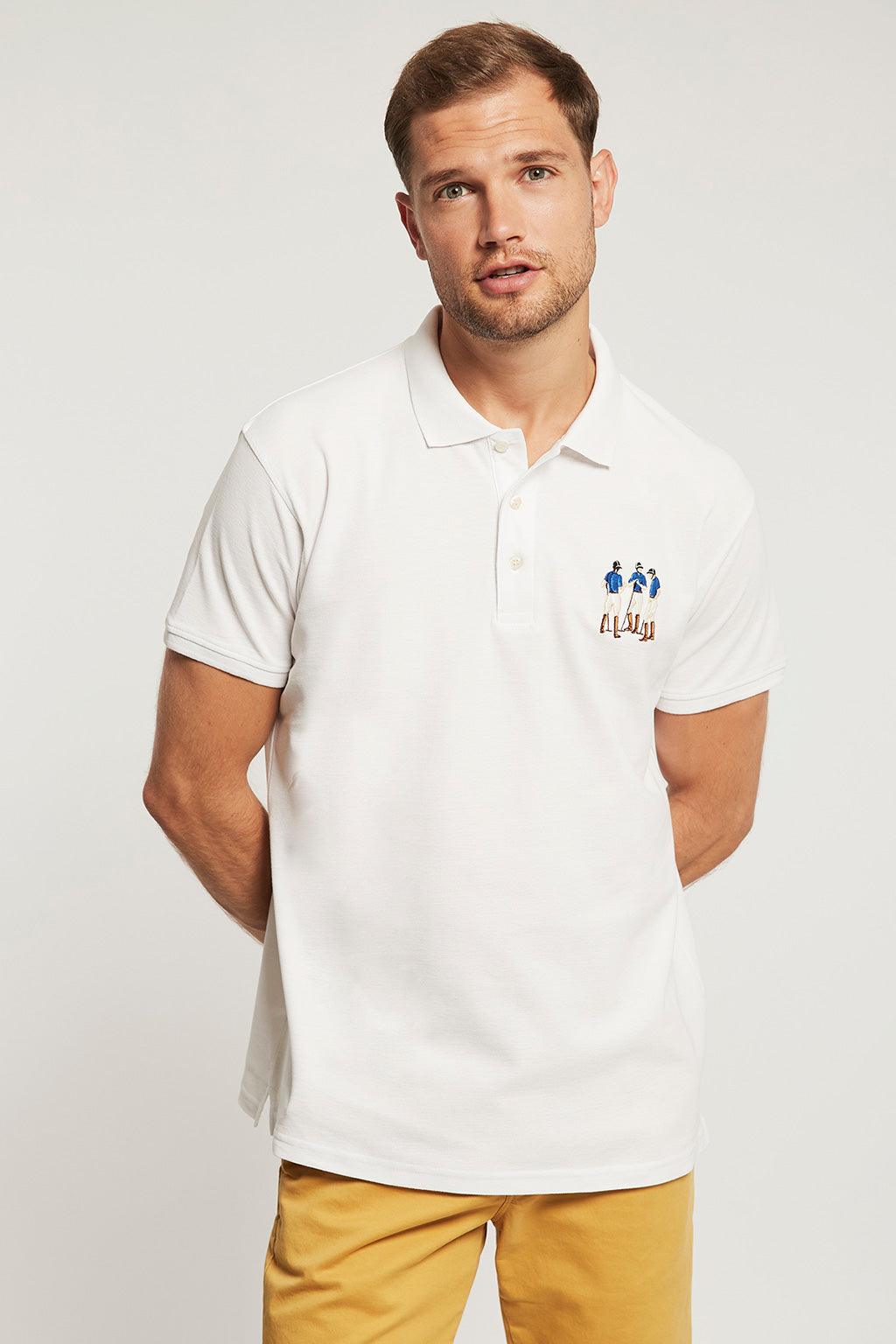 Custom fit white polo shirt with multicoloured embroidery